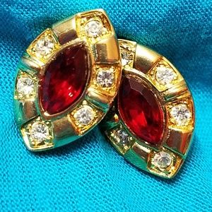 Gold tone earrings with faux ruby and rhinestones